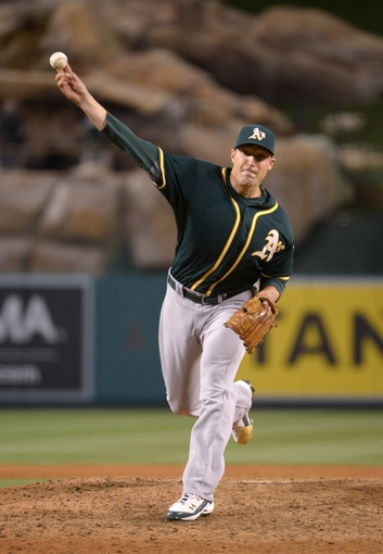 Jun 9, 2014; Anaheim, CA, USA; Oakland Athletics reliever Jim Johnson delivers a pitch against the Los Angeles Angels at Angel Stadium of Anaheim. The Angels defeated the Athletics 4-1. Mandatory Credit: Kirby Lee-USA TODAY Sports