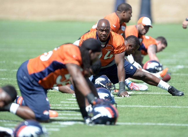 Jun 10, 2014; Denver, CO, USA; Denver Broncos defensive end DeMarcus Ware (94) warms up during mini camp at the Broncos practice facility. Mandatory Credit: Ron Chenoy-USA TODAY Sports