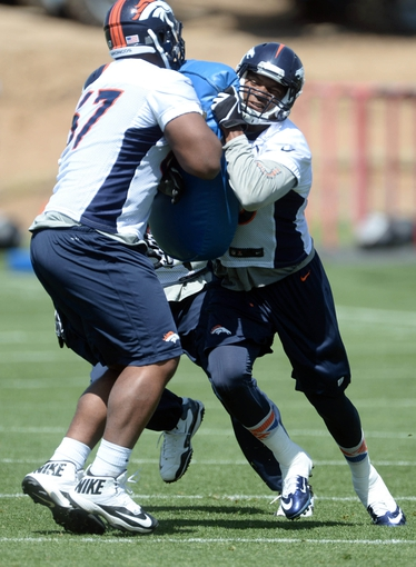 Jun 10, 2014; Denver, CO, USA; Denver Broncos tight end Julius Thomas (80) and tackle Aslam Sterling (67) during mini camp drills at the Broncos practice facility. Mandatory Credit: Ron Chenoy-USA TODAY Sports