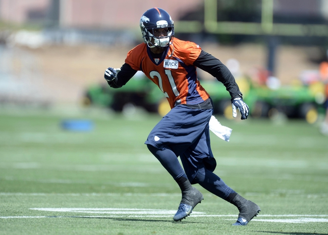 Jun 10, 2014; Denver, CO, USA; Denver Broncos cornerback Aqib Talib (21) warms up during mini camp drills at the Broncos practice facility. Mandatory Credit: Ron Chenoy-USA TODAY Sports