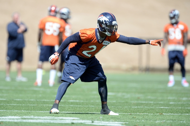 Jun 10, 2014; Denver, CO, USA; Denver Broncos free safety Rahim Moore (26) during mini camp drills at the Broncos practice facility. Mandatory Credit: Ron Chenoy-USA TODAY Sports