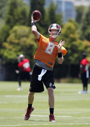 Jun 10, 2014; Tampa Bay, FL, USA;Tampa Bay Buccaneers quarterback Mike Glennon (8) throws the ball as he works out during mini camp at One Buccaneer Place. Mandatory Credit: Kim Klement-USA TODAY Sports