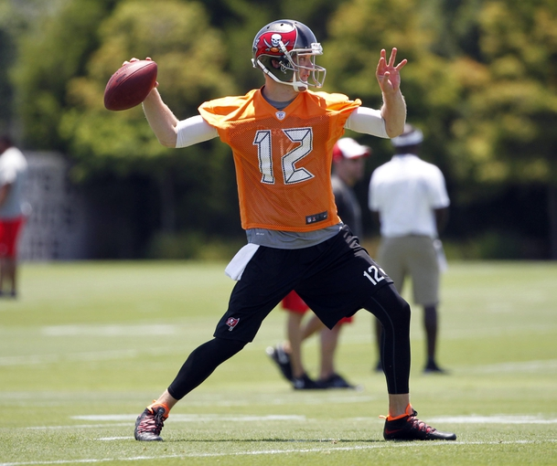 Jun 10, 2014; Tampa Bay, FL, USA;  Tampa Bay Buccaneers quarterback Josh McCown (12) works out during mini camp at One Buccaneer Place. Mandatory Credit: Kim Klement-USA TODAY Sports