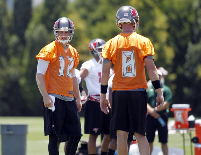 Jun 10, 2014; Tampa Bay, FL, USA;  Tampa Bay Buccaneers quarterback Josh McCown (12) and quarterback Mike Glennon (8) during mini camp at One Buccaneer Place. Mandatory Credit: Kim Klement-USA TODAY Sports