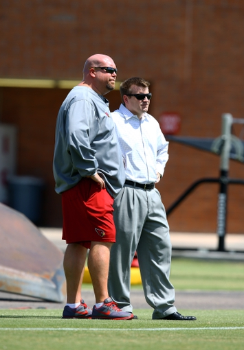 Jun 10, 2014; Tempe, AZ, USA; Arizona Cardinals general manager Steve Keim (left) with president Michael Bidwill on the sidelines during mini camp at the teams Tempe training facility. Mandatory Credit: Mark J. Rebilas-USA TODAY Sports