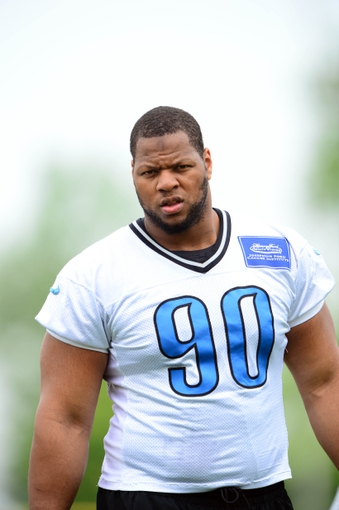 Jun 10, 2014; Detroit, MI, USA; Detroit Lions defensive tackle Ndamukong Suh (90) during mini camp at Detroit Lions training facility. Mandatory Credit: Andrew Weber-USA TODAY Sports
