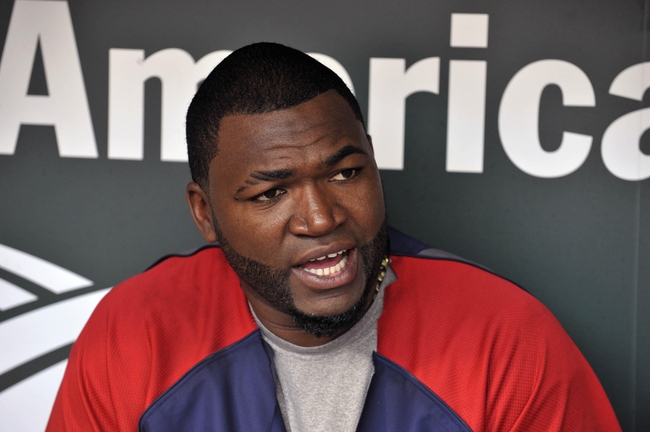 Jun 10, 2014; Baltimore, MD, USA; Boston Red Sox designated hitter David Ortiz (34) in the dugout prior to a game against the Baltimore Orioles at Oriole Park at Camden Yards. Mandatory Credit: Joy R. Absalon-USA TODAY Sports