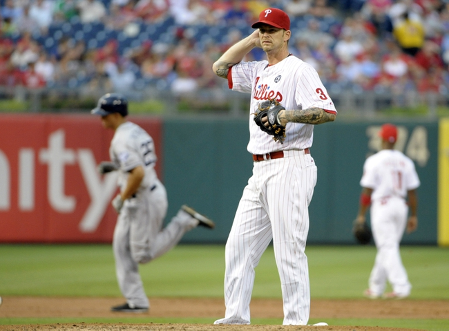 Jun 10, 2014; Philadelphia, PA, USA; Philadelphia Phillies starting pitcher A.J. Burnett (34) reacts after allowing a home run during the third inning against San Diego Padres right fielder Will Venable (25) at Citizens Bank Park. Mandatory Credit: Eric Hartline-USA TODAY Sports