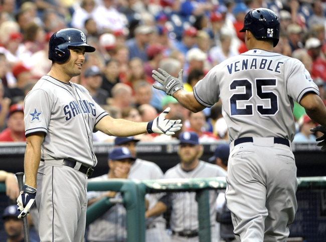 Jun 10, 2014; Philadelphia, PA, USA; San Diego Padres right fielder Will Venable (25) gets congratulations from left fielder Seth Smith (12) after hitting a home run in the third inning against the Philadelphia Phillies at Citizens Bank Park. Mandatory Credit: Eric Hartline-USA TODAY Sports