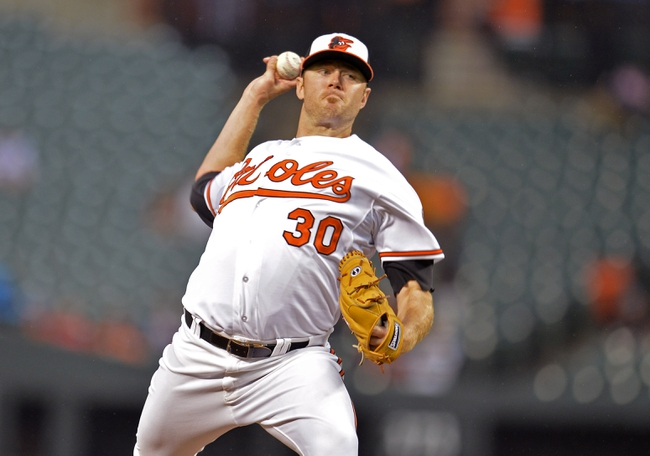 Jun 10, 2014; Baltimore, MD, USA; Baltimore Orioles starting pitcher Chris Tillman (30) throws in the second inning against the Boston Red Sox at Oriole Park at Camden Yards. Mandatory Credit: Joy R. Absalon-USA TODAY Sports