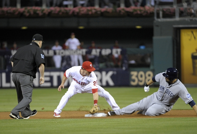 Jun 10, 2014; Philadelphia, PA, USA; San Diego Padres left fielder Carlos Quentin (18) slides safely into second base ahead of tag by Philadelphia Phillies second baseman Chase Utley (26) in the seventh inning at Citizens Bank Park. Phillies defeated the Padres, 5-2. Mandatory Credit: Eric Hartline-USA TODAY Sports