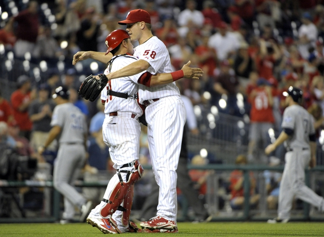 Jun 10, 2014; Philadelphia, PA, USA; Philadelphia Phillies relief pitcher Jonathan Papelbon (58) and catcher Carlos Ruiz (51) celebrate final out against the San Diego Padres at Citizens Bank Park. Phillies defeated the Padres, 5-2. Mandatory Credit: Eric Hartline-USA TODAY Sports