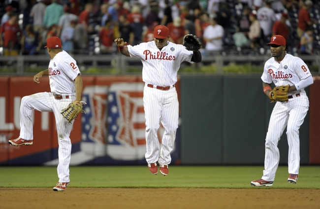Jun 10, 2014; Philadelphia, PA, USA; Philadelphia Phillies Philadelphia Phillies center fielder Ben Revere (2), right fielder Marlon Byrd (3) and left fielder Domonic Brown (9) celebrate win against the San Diego Padres at Citizens Bank Park. Phillies defeated the Padres, 5-2. Mandatory Credit: Eric Hartline-USA TODAY Sports