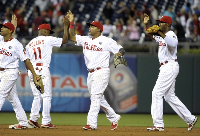 Jun 10, 2014; Philadelphia, PA, USA; Philadelphia Phillies right fielder Marlon Byrd (3) celebrates win with teammates shortstop Jimmy Rollins (11) and left fielder Domonic Brown (9) against the San Diego Padres at Citizens Bank Park. Phillies defeated the Padres, 5-2. Mandatory Credit: Eric Hartline-USA TODAY Sports