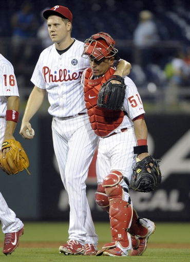 Jun 10, 2014; Philadelphia, PA, USA; Philadelphia Phillies relief pitcher Jonathan Papelbon (58) and catcher Carlos Ruiz (51) walk off the field after win against the San Diego Padres at Citizens Bank Park. Phillies defeated the Padres, 5-2. Mandatory Credit: Eric Hartline-USA TODAY Sports