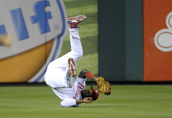 Jun 10, 2014; Philadelphia, PA, USA; Philadelphia Phillies left fielder Domonic Brown (9) tumbles after making a catch against the San Diego Padres in the seventh inning at Citizens Bank Park. Phillies defeated the Padres, 5-2. Mandatory Credit: Eric Hartline-USA TODAY Sports