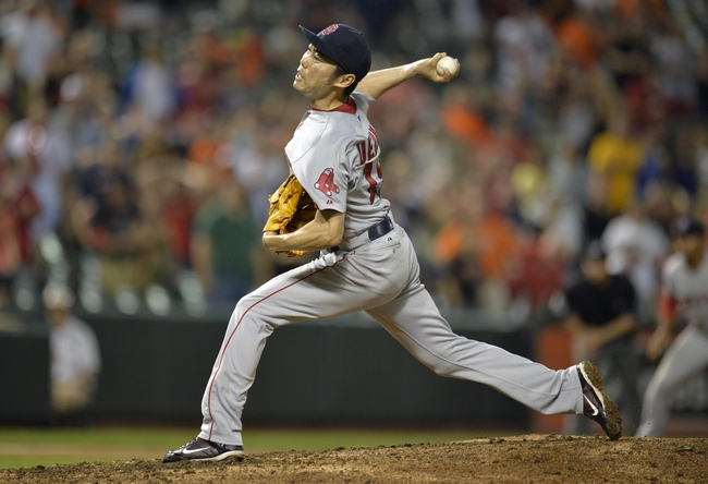 Jun 10, 2014; Baltimore, MD, USA; Boston Red Sox pitcher Koji Uehara (19) pitches in the ninth inning against the Baltimore Orioles at Oriole Park at Camden Yards. The Red Sox defeated the Orioles 1-0. Mandatory Credit: Joy R. Absalon-USA TODAY Sports