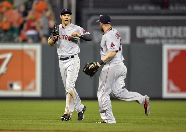 Jun 10, 2014; Baltimore, MD, USA; Boston Red Sox outfielders Grady Sizemore (left) and Jonny Gomes (right) celebrate after a game against the Baltimore Orioles at Oriole Park at Camden Yards. The Red Sox defeated the Orioles 1-0. Mandatory Credit: Joy R. Absalon-USA TODAY Sports
