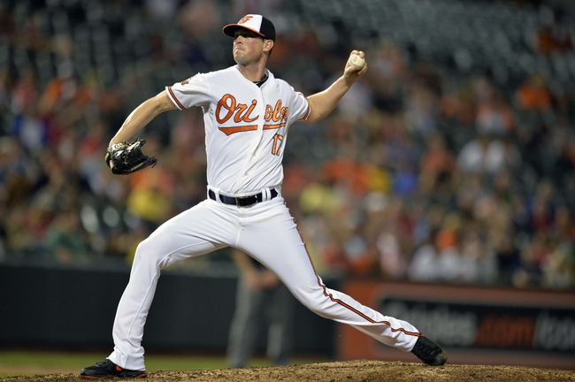 Jun 10, 2014; Baltimore, MD, USA; Baltimore Orioles pitcher Brian Matusz (17) pitches in the eighth inning against the Boston Red Sox at Oriole Park at Camden Yards. The Red Sox defeated the Orioles 1-0. Mandatory Credit: Joy R. Absalon-USA TODAY Sports