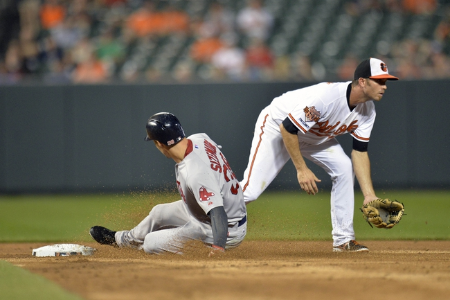 Jun 10, 2014; Baltimore, MD, USA; Boston Red Sox center fielder Grady Sizemore (38) is safe at second base on a throwing error by Baltimore Orioles second baseman Ryan Flaherty (not shown) as J.J. Hardy (2) does not get the throw in time during the sixth inning at Oriole Park at Camden Yards. The Red Sox defeated the Orioles 1-0. Mandatory Credit: Joy R. Absalon-USA TODAY Sports