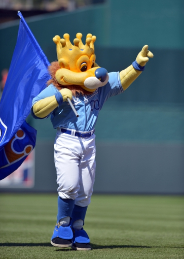 Jun 11, 2014; Kansas City, MO, USA; The Kansas City Royals mascot Sluggerrr celebrates after the game against the Cleveland Indians at Kauffman Stadium. The Royals won 4-1. Mandatory Credit: Denny Medley-USA TODAY Sports