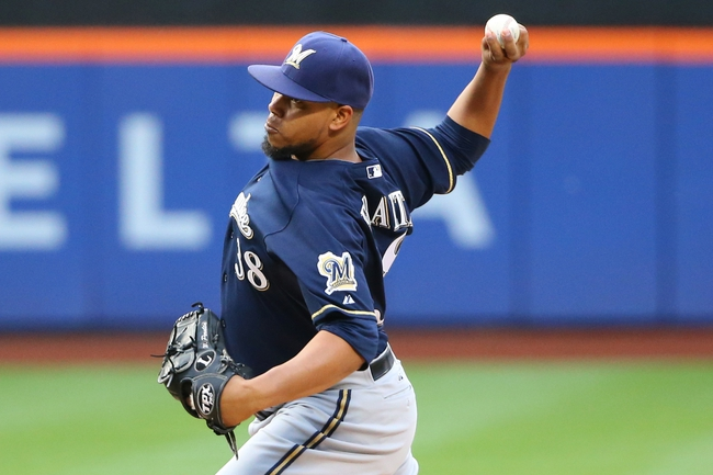 Jun 11, 2014; New York, NY, USA; Milwaukee Brewers starting pitcher Wily Peralta (38) pitches during the first inning against the New York Mets at Citi Field. Mandatory Credit: Anthony Gruppuso-USA TODAY Sports