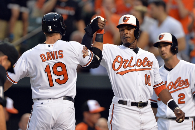 Jun 11, 2014; Baltimore, MD, USA;  Baltimore Orioles first baseman Chris Davis (19) celebrates with  center fielder Adam Jones (10) at home plate after Davis' home run in the first inning against the Boston Red Sox   at Oriole Park at Camden Yards. Mandatory Credit: Tommy Gilligan-USA TODAY Sports