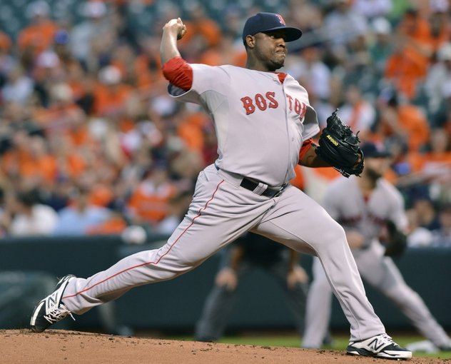 Jun 11, 2014; Baltimore, MD, USA;  Boston Red Sox starting pitcher Rubby De La Rosa (62) pitches during the first inning against the Baltimore Orioles at Oriole Park at Camden Yards. Mandatory Credit: Tommy Gilligan-USA TODAY Sports