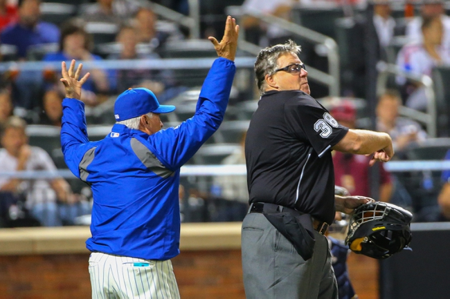 Jun 11, 2014; New York, NY, USA;  Umpire Gary Cederstrom (38) ejects New York Mets manager Terry Collins (10) after arguing a challenge review during the fifth inning against the Milwaukee Brewers at Citi Field. Mandatory Credit: Anthony Gruppuso-USA TODAY Sports