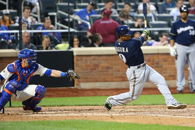 Jun 11, 2014; New York, NY, USA;  Milwaukee Brewers shortstop Jean Segura (9) singles to left allowing a runner to score during the fourth inning against the New York Mets at Citi Field. Mandatory Credit: Anthony Gruppuso-USA TODAY Sports