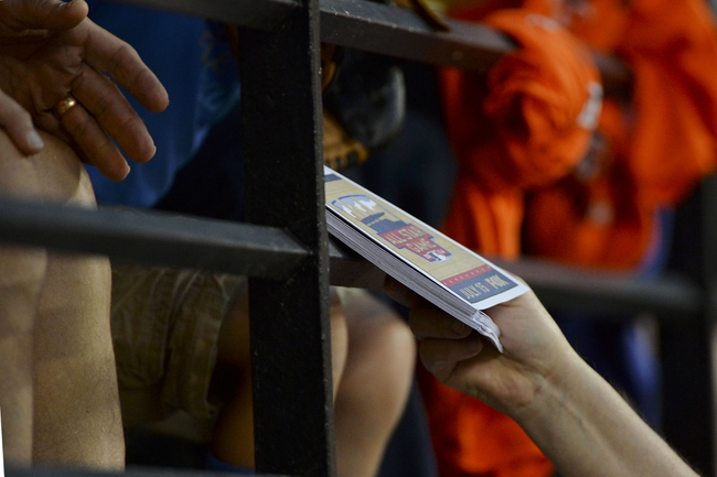 Jun 11, 2014; Baltimore, MD, USA;  Baltimore Orioles employees hand out Allstar Ballots during the fourth inning of the game against the Boston Red Sox at Oriole Park at Camden Yards. Mandatory Credit: Tommy Gilligan-USA TODAY Sports