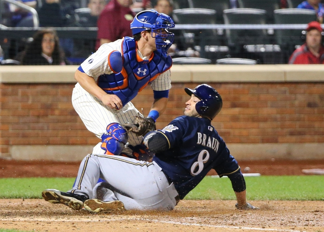 Jun 11, 2014; New York, NY, USA;  New York Mets catcher Taylor Teagarden (23) throws out Milwaukee Brewers right fielder Ryan Braun (8) during the seventh inning at Citi Field. Mandatory Credit: Anthony Gruppuso-USA TODAY Sports