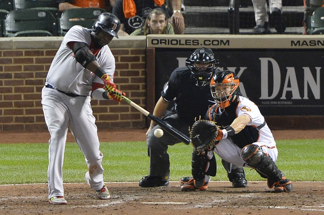 Jun 11, 2014; Baltimore, MD, USA;  Boston Red Sox designated hitter David Ortiz (34) hits into a inning ending double play during the seventh inning against the Baltimore Orioles at Oriole Park at Camden Yards. Mandatory Credit: Tommy Gilligan-USA TODAY Sports