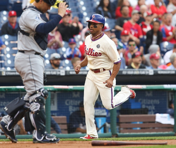 Jun 12, 2014; Philadelphia, PA, USA; Philadelphia Phillies center fielder Ben Revere (2) scores a run during the first inning of a game against the San Diego Padres at Citizens Bank Park. Mandatory Credit: Bill Streicher-USA TODAY Sports