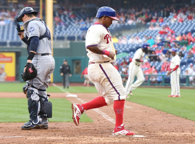 Jun 12, 2014; Philadelphia, PA, USA; Philadelphia Phillies right fielder Marlon Byrd (3) scores on a sacrifice fly during the fourth inning of a game against the San Diego Padres at Citizens Bank Park. Mandatory Credit: Bill Streicher-USA TODAY Sports