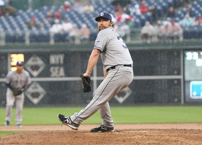 Jun 12, 2014; Philadelphia, PA, USA; San Diego Padres relief pitcher Dale Thayer (33) pitches during the sixth inning of a game against the Philadelphia Phillies at Citizens Bank Park. The Phillies won 7-3. Mandatory Credit: Bill Streicher-USA TODAY Sports