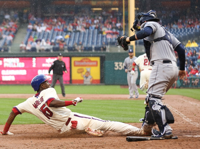 Jun 12, 2014; Philadelphia, PA, USA; Philadelphia Phillies first baseman John Mayberry Jr. (15) is tagged out at home plate by San Diego Padres catcher Yasmani Grandal (8) during the sixth inning of a game at Citizens Bank Park. The Phillies won 7-3. Mandatory Credit: Bill Streicher-USA TODAY Sports