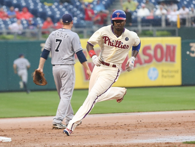 Jun 12, 2014; Philadelphia, PA, USA; Philadelphia Phillies left fielder Domonic Brown (9) rounds third as he runs home to score during the seventh inning a game against the San Diego Padres at Citizens Bank Park. The Phillies won 7-3. Mandatory Credit: Bill Streicher-USA TODAY Sports