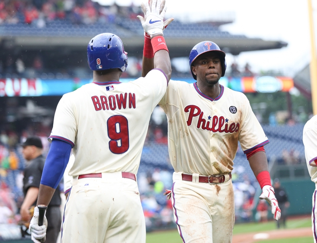Jun 12, 2014; Philadelphia, PA, USA; Philadelphia Phillies first baseman John Mayberry Jr. (15) is congratulated by left fielder Domonic Brown (9) after hitting a three run home run during the seventh inning of a game against the San Diego Padres at Citizens Bank Park. The Phillies won 7-3. Mandatory Credit: Bill Streicher-USA TODAY Sports