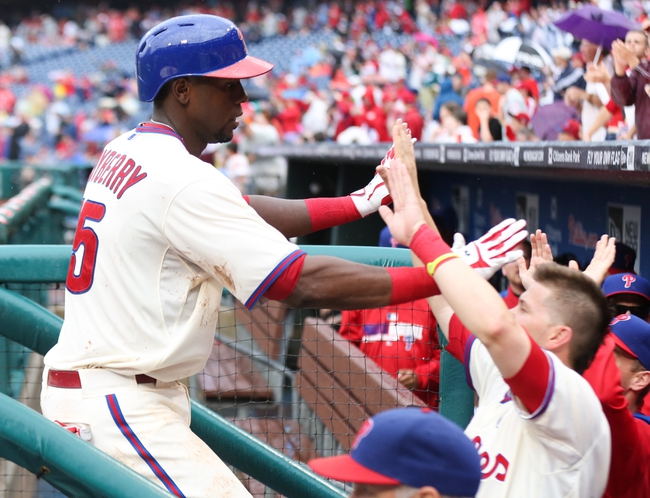 Jun 12, 2014; Philadelphia, PA, USA; Philadelphia Phillies first baseman John Mayberry Jr. (15) is congratulated by team mates in the dugout after hitting a three run home run during the seventh inning of a game against the San Diego Padres at Citizens Bank Park. The Phillies won 7-3. Mandatory Credit: Bill Streicher-USA TODAY Sports