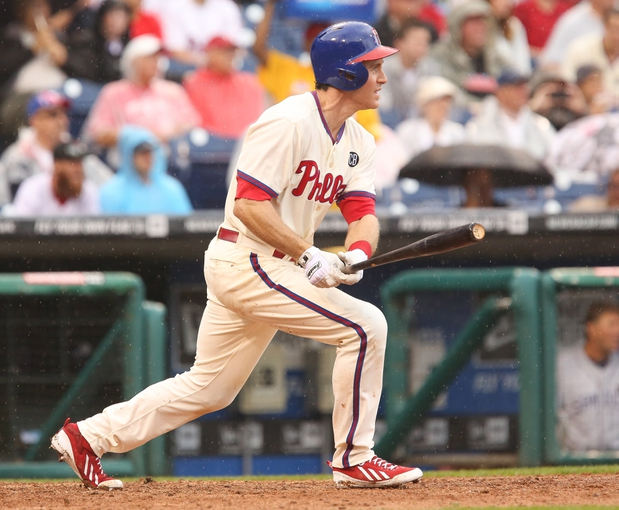 Jun 12, 2014; Philadelphia, PA, USA; Philadelphia Phillies second baseman Chase Utley (26) singles to center during the fifth inning of a game against the San Diego Padres at Citizens Bank Park. The Phillies won 7-3. Mandatory Credit: Bill Streicher-USA TODAY Sports