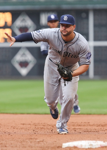 Jun 12, 2014; Philadelphia, PA, USA; San Diego Padres first baseman Yonder Alonso (23) fields a ground ball in a game against the Philadelphia Phillies at Citizens Bank Park. The Phillies won 7-3. Mandatory Credit: Bill Streicher-USA TODAY Sports