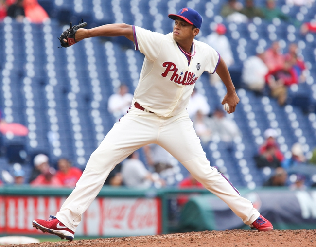 Jun 12, 2014; Philadelphia, PA, USA; Philadelphia Phillies relief pitcher Mario Hollands (43) pitches ninth inning a game against the San Diego Padres at Citizens Bank Park. The Phillies won 7-3. Mandatory Credit: Bill Streicher-USA TODAY Sports