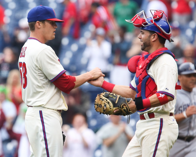 Jun 12, 2014; Philadelphia, PA, USA; Philadelphia Phillies relief pitcher Ken Giles (53) is congratulated by catcher Wil Nieves (21) at the conclusion of a game against the San Diego Padres at Citizens Bank Park. The Phillies won 7-3. Mandatory Credit: Bill Streicher-USA TODAY Sports