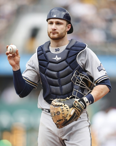 Jun 8, 2014; Pittsburgh, PA, USA; Milwaukee Brewers catcher Jonathan Lucroy (20) on the field against the Pittsburgh Pirates during the seventh inning at PNC Park. The Brewers won 1-0. Mandatory Credit: Charles LeClaire-USA TODAY Sports