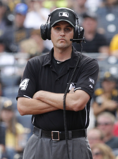 Jun 8, 2014; Pittsburgh, PA, USA; MLB umpire John Tumpane (74) awaits a decision from the MLB replay center during the ninth inning of the game between the Milwaukee Brewers and the Pittsburgh Pirates at PNC Park. The Brewers won 1-0. Mandatory Credit: Charles LeClaire-USA TODAY Sports