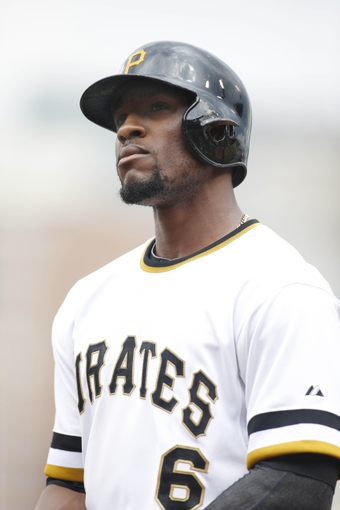 Jun 8, 2014; Pittsburgh, PA, USA; Pittsburgh Pirates left fielder Starling Marte (6) at bat against the Milwaukee Brewers during the seventh inning at PNC Park. The Brewers won 1-0. Mandatory Credit: Charles LeClaire-USA TODAY Sports