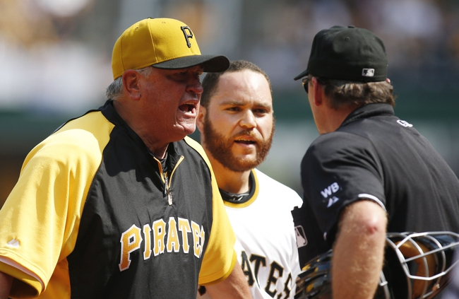 Jun 8, 2014; Pittsburgh, PA, USA; Pittsburgh Pirates manager Clint Hurdle (L) argues with home plate umpire Ed Hickox (R) after catcher Russell Martin (C) was ejected against the Milwaukee Brewers during the eighth inning at PNC Park. The Brewers won 1-0. Mandatory Credit: Charles LeClaire-USA TODAY Sports