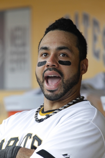 Jun 8, 2014; Pittsburgh, PA, USA; Pittsburgh Pirates third baseman Pedro Alvarez (24) reacts in the dugout while watching a scoreboard replay of a play under review against the Milwaukee Brewers during the ninth inning at PNC Park. The Brewers won 1-0. Mandatory Credit: Charles LeClaire-USA TODAY Sports