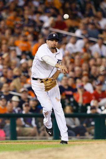 Jun 7, 2014; Detroit, MI, USA; Detroit Tigers third baseman Nick Castellanos (9) makes a throw against the Boston Red Sox at Comerica Park. Mandatory Credit: Rick Osentoski-USA TODAY Sports